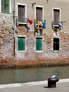 Italy, Venice - Canal and Clothes