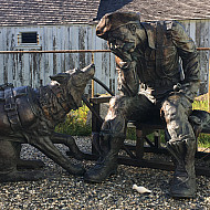 Skagway bronze statue with man and dog